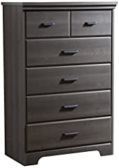 Traditional Lines And Beveled Edges              This Versa Collection 5-drawer dresser offers a timeless look with ample storage. The beautiful beveled edges, curved kick plate, and antique straight metal handles make this dr...
