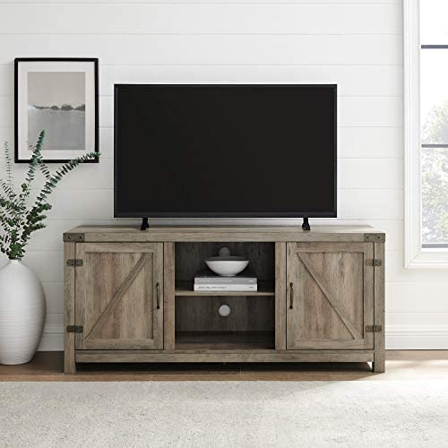 41mFrl6hMHL. AC Walker Edison Georgetown Modern Farmhouse Double Barn Door TV Stand for TVs up to 65 Inches, 58 Inch, Grey    Include our TV stand in your living room to give the area a charming, country feel. Features concealed storage space behind the barn styled side doors with adjustable shelving to fit your media and accessories, while having a mix of rustic and modern farmhouse style. This entertainment center is made of durable, high-grade MDF and can support most TVs up to 65-inches. As a storage console, it will keep your living room looking neat while also giving it a homespun feel.