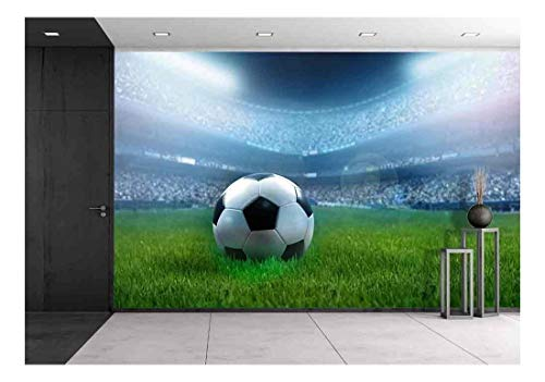 wall26 - Close Up of a Football Ball on a Full Stadium - Removable Wall Mural | Self-Adhesive Large Wallpaper - 100x144 inches
