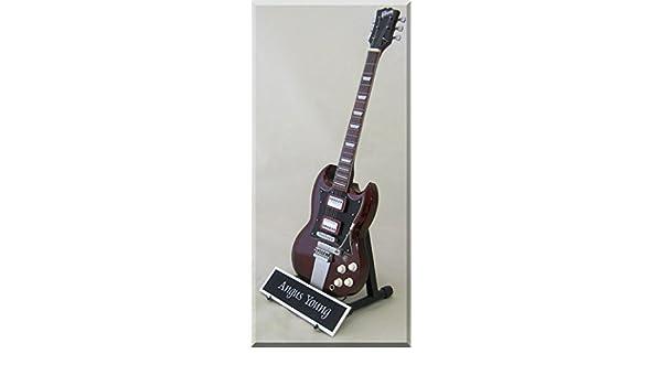 Angus Young Guitarra en miniatura AC/DC con nombre: Amazon.es: Instrumentos musicales