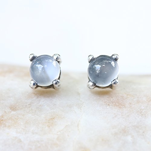 Sterling silver stud earrings with cabochon white moonstone in prongs setting with sterling silver post and backing ()