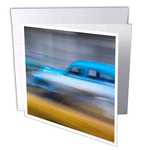 3dRose Danita Delimont - Cars - Classic car speeds by in a Blur Along The Streets of Havana. - 1 Greeting Card with Envelope (gc_312987_5)