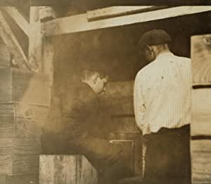 1910 child labor photo 2 boys at the filling machine in Cannon's Cannery, Bri b2
