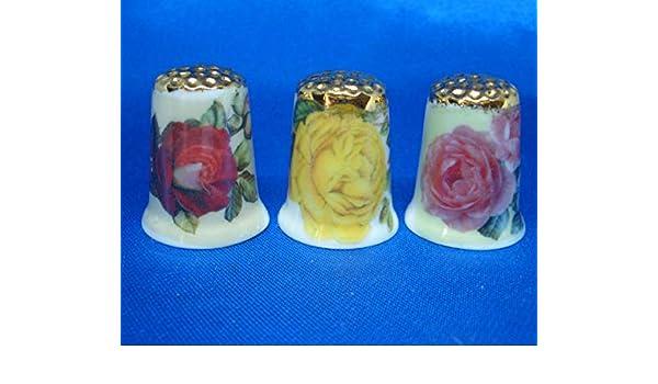 FINE PORCELAIN CHINA THIMBLES SET OF THREE  TRELLIS FLOWERS GOLD TOP