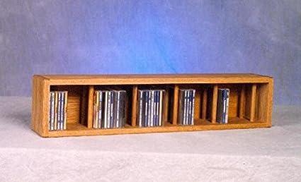 67 CD Wall Mount Storage Rack Finish: Unfinished