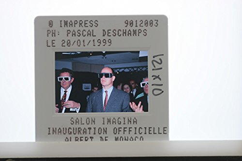 Slides photo of Albert II, Prince of Monaco wearing 3D glasses in Imagine Salon.