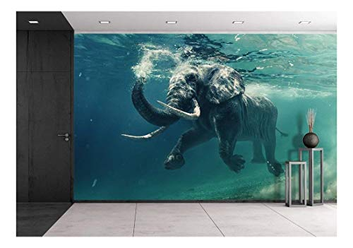 Swimming Elephant Underwater African elephant in ocean with mirrors and ripples at water surface