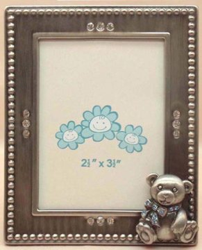 Simple yet adorable 2.5x3.5 metal frame decorated with clear rhinestones and an adorable teddy bear adorned with blue crystals. Perfect for framing an adorable baby boy and the family who loves him.
