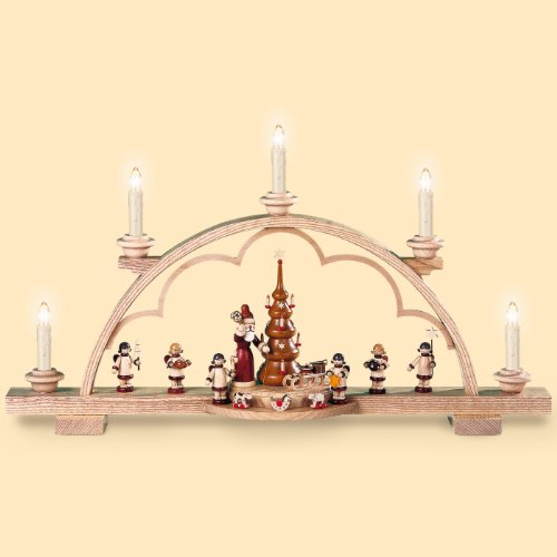 German candle arch Santa giving out Christmas presents, length 57 cm / 22 inch, natural, electrical illuminated (230V, 50Hz), original Erzgebirge by Mueller Seiffen by ISDD Cuckoo Clocks