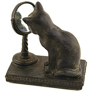 cat looking in mirror figurine