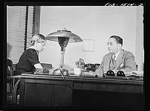 Reproduced Photo of Mr. Albert W. Williams, president of the Unity Life Insurance Company, dictating to secretary DeAcklin. Mr. Williams was born in Georgia, studied at the Univ 1942 Delano C Jack 71a