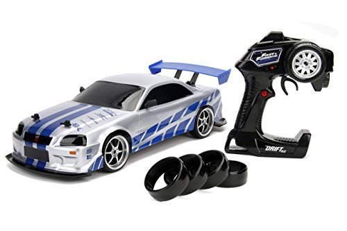 Jada 99701 Toys Fast & Furious Brian's Nissan Skyline GT-R (BN34) Drift Power Slide RC Radio Remote Control Toy Race Car with Extra Tires, 1:10 Scale, Silver/Blue (Renewed)