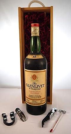 The Glenlivet 12 year old Malt Whisky bottled 1980's 1.13 Litres en una caja de madera forrada de seda con cuatro accesorios de vino, 1 x1130ml