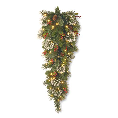 National Tree 3 Foot Wintry Pine Slim Teardrop Swag with Cones, Red Berries, Snowflakes and 50 Warm White Battery Operated LED Lights with Timer (WP1-300-3TB-1) ()