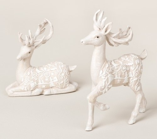 Christmas Tablescape Decor - A pair of beautiful winter white deer figurines, 1 standing and 1 sitting, with intricately paper cut scroll designed and Christmas scene accents