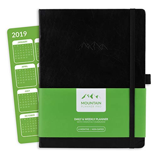 Mountain Daily Planner Pro - Large Undated Daily, Weekly Gratitude Journal and Monthly Calendar. Increase Productivity, Track Budget, Tasks and Goals in 2019. Hardcover, Pen Holder. 6 Months. Black