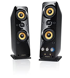 Black and gold speakers standing side by side