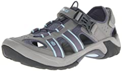 The Omnium sandal is versatile enough for all of your adventures. Quick-drying synthetic upper. Quick-release buckle for easy entry/exit. Integrated toe-protection. Encapsulated Shoc Pad™ in the heel. Microban® zinc based anti-microbial prot...