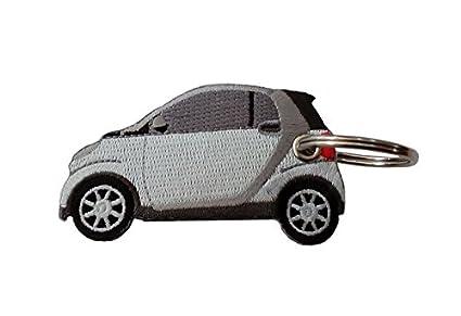 Moto Discovery Smart Blanco Llavero Doble Cara: Amazon.es ...