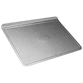 USA Pan Bakeware Aluminized Steel Cookie Sheet, Large 5 Made in the USA aluminized steel Small cookie scoop pan, commercial grade and heavy gauge Unique corrugated surface design facilitates air circulation for evenly baked goods and quick release Coated with Americoat - a silicone that is PTFE, PFOA and BPA free; made with a blend of New and recycled steel; Limited life-time