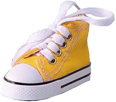 Llavero con forma de zapatilla amarilla en miniatura: Amazon ...