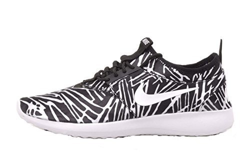 Nike Women's Juvenate Print Round Toe Canvas Running Shoe...