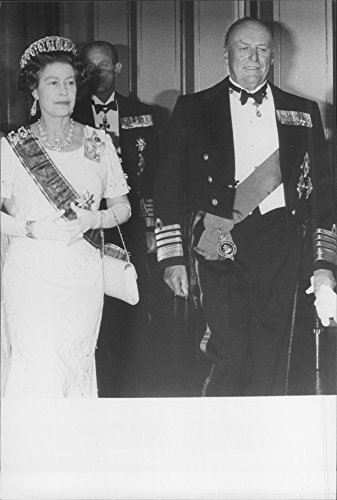 - Vintage photo of Queen Elizabeth of Great Britain arrives at the royal dinner in Oslo Castle during Norway's visit. Here with King Olav of Norway