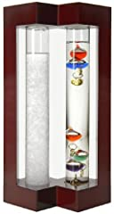 This beautiful conversation piece combines two ancient technologies - the Admiral Fitzroy Storm Glass and the Galileo Thermometer. The Admiral Fitzroy Storm Glass: How this storm glass really works is a mystery, but it is believed that electr...