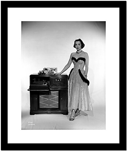 Jane Wyman Posed in White Silk Dress with Gathered Long Skirt with Right Hand on the Radio Box Premium Art Print (Framed 8x10)