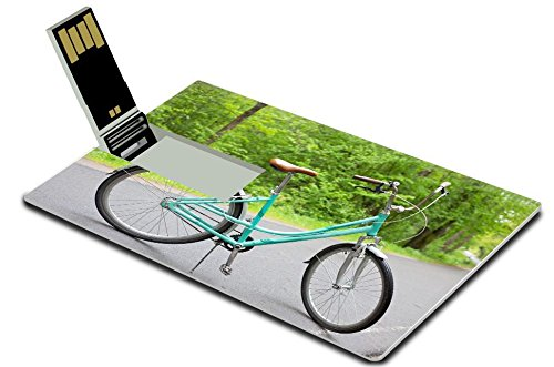 Luxlady 32GB USB Flash Drive 2.0 Memory Stick Credit Card Size vintage blue bicycle on the road in the forest IMAGE 28460333