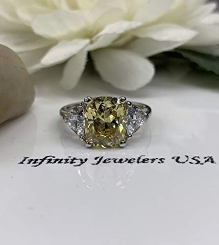 - Canary yellow elongated cushion cut engagement ring with trillion accents