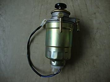 diesel fuel filter base w/ primer pump + filter /water trap universal  application inc water sensor (8mm 5/16 hose), filters - amazon canada
