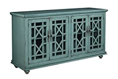 The jules TV stand features a beautiful Teal finish with sophisticated transitional styling inspired by design cues taken from Parisian antique markets. Elegant trellis details on the glass doors, intricately cast door pulls, turned bun feet,...