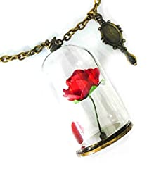 Add a delicate dash of timeless elegance with this beautiful Beast Bella necklace that inspired the recent romantic film. The stunning red rose is balanced in a glass vial and it hangs with an antique rust gold chain that gives classy looks. ...