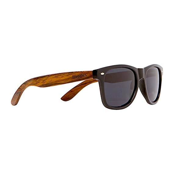 Woodies Walnut Wood Sunglasses with Black Polarized Lenses for Men or Women 1 COMFORTABLE: 50% Lighter than Ray-Bans SAFETY: Polarized Lenses Provide 100% UVA/UVB Protection EXTRAS: Includes FREE Carrying Case, Lens Cloth, and Wood Guitar Pick