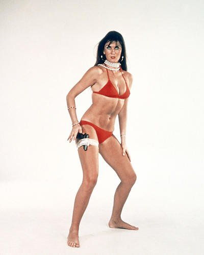 The Spy Who Loved Me Caroline Munro 8x10 Promotional Photograph in red bikini with gun in garter belt