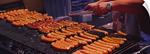 "Canvas on Demand Wall Peel Wall Art Print entitled Close-up of a mans hand cooking hot dogs on a barbecue grill, Taste of Chicago, Chicago, Illinois 48""x17"""