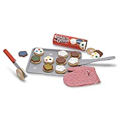 """Slice and """"bake"""" a dozen wooden cookies for a sweet playtime treat; This colorful wooden set includes 12 wooden, sliceable cookies and 12 toppings, wooden knife, spatula, cookie sheet and a kitchen mitt for safe, deliciously imaginative play;..."""
