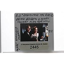 Slides photo of Brian Benben and Mary Stuart Masterson in Radioland Murders movie39;s scene.