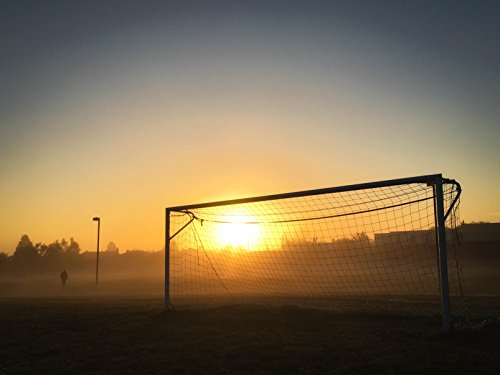 Home Comforts LAMINATED POSTER Person Jogging Near Soccer Goal During Sunrise Sunset Poster Print 24 x 36 by Home Comforts