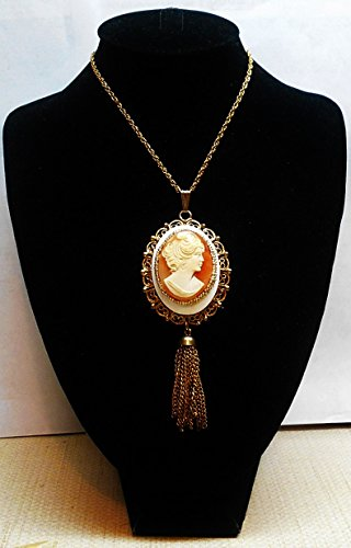 - Vintage Large Hand Carved Shell Cameo Lady Wearing A Dainty Hat, Embellished by Gold Seed Beads on Gold Tone Filigree Tassel Necklace