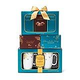 The Godiva Celebration Tower Gift Set   Contains 2 Ceramic Mugs (9 oz.), Godiva Milk & Dark Chocolate Cocoa, Salted Caramels, Caramel Popcorn, and Chocolate Chip Cookies