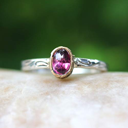 Tiny oval cabochon pink spinel ring in 18k gold bezel setting with sterling silver in leaf design engraving band