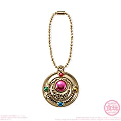 "From Bandai Japan: We are pleased to introduce to you our new item, ""Little Charm Sailor Moon"". This is a collectible little charm that comes with a gold ball chain. Approximate size is 1-1/2 inches. Note: Does not include candy."
