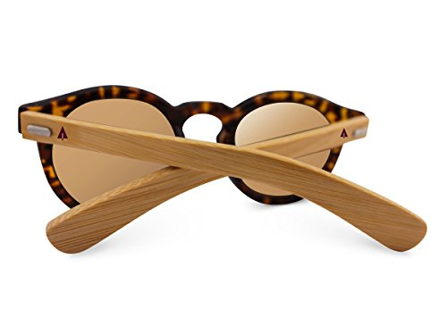 Treehut Wooden Bamboo Sunglasses Temples Round Vintage Oversize Wood Sunglasses 3 NATURE-FRIENDLY - The Treehut Wooden Bamboo Sunglasses in Round Vintage Style are environmentally conscious because they are made of highly sustainable bamboo. When bamboo is harvested, it renews itself readily, making it an endlessly renewable resource. TIMELESS DESIGN - These vintage sunglasses are classic and elegant, exuding a trendy feeling with hints of an old-school style, making them ideal for trips to the beach or leisurely strolls around town. They best complement square-shaped faces, but they are also suitable for a variety of other face shapes. They can be worn by ladies and gentlemen alike. HIGH-GRADE LENSES - The brown lenses offer 100% protection against harmful UVA/UVB rays, allowing you to have all the fun under the sun without straining your eyes.