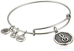 Handmade bangle bracelet crafted from recycled material featuring initial pendant and three stamped Alex and Ani charms. Alex and Ani's patented expandable wire bangle concept allows the wearer to adjust the bangle for a perfect fit.