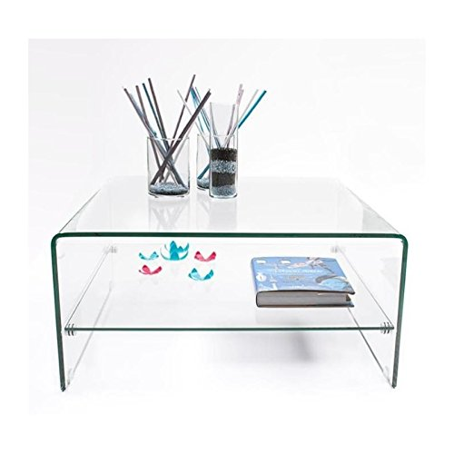 Práctica mesa de centro transparente realizada en una pieza con revistero. Estética suave y acogedora.