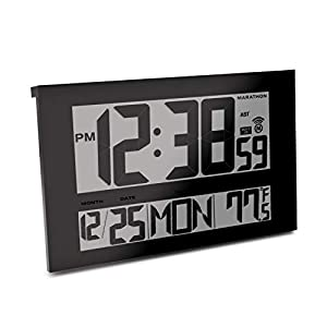 Standing atomic clock which is showing the time