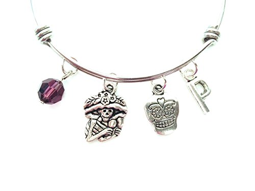 Day of the Dead / Dia de los Muertos themed personalized bangle bracelet. Antique silver charms and a genuine Swarovski birthstone colored element.