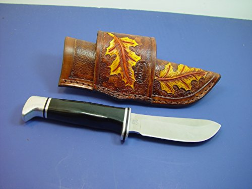 buck 103 custom leather cross draw knife sheath  the sheath is made out of 8 oz  leather and is